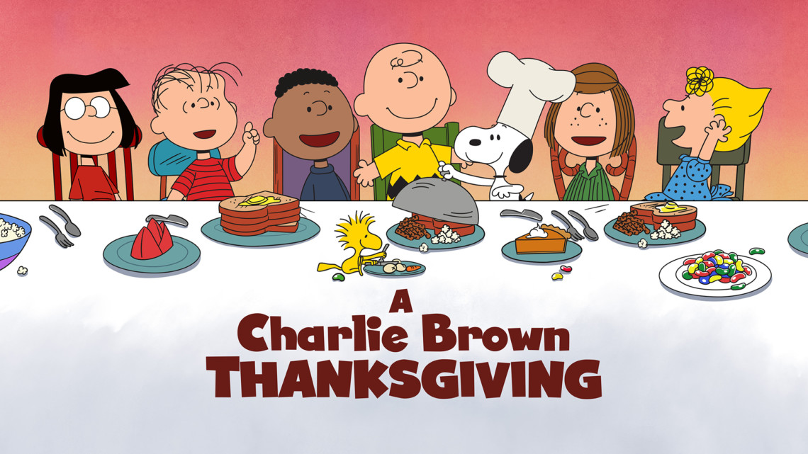 the peanuts gang sitting at a big thanksgiving table with the words: A Charlie Brown Thanksgiving underneath