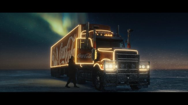 Image of a lit up Coca-Cola truck