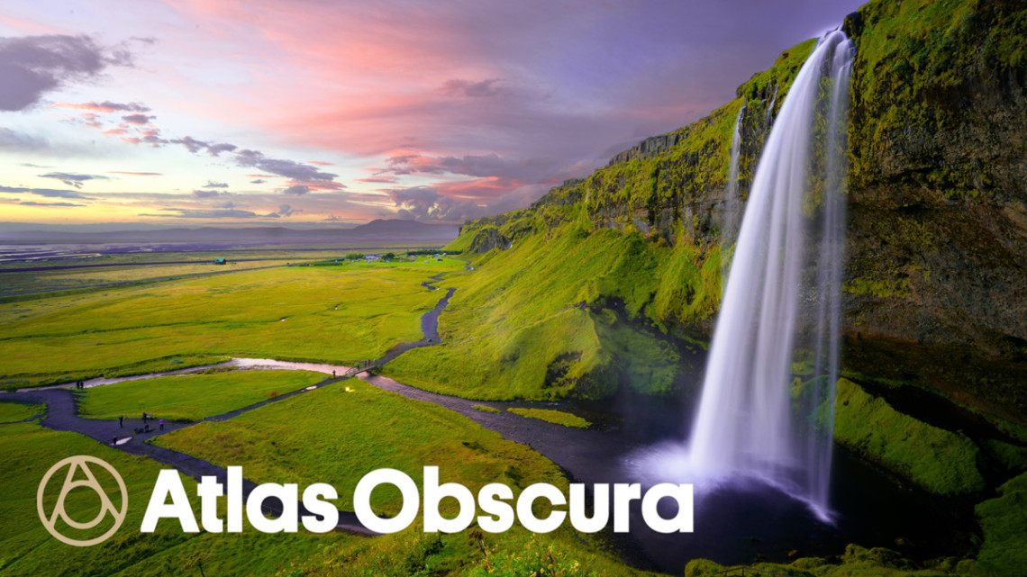atlas obscura logo on a beautiful landscape with a setting sun and waterfall