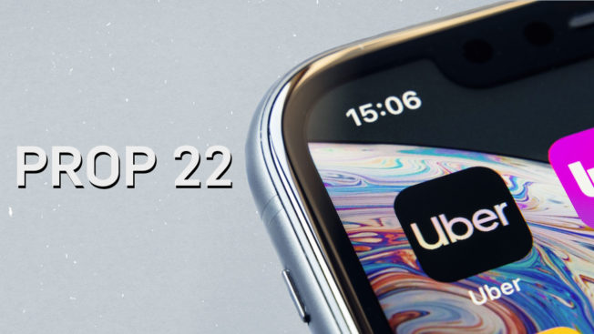 phone screen with the uber logo on the right and prop 22 on the left