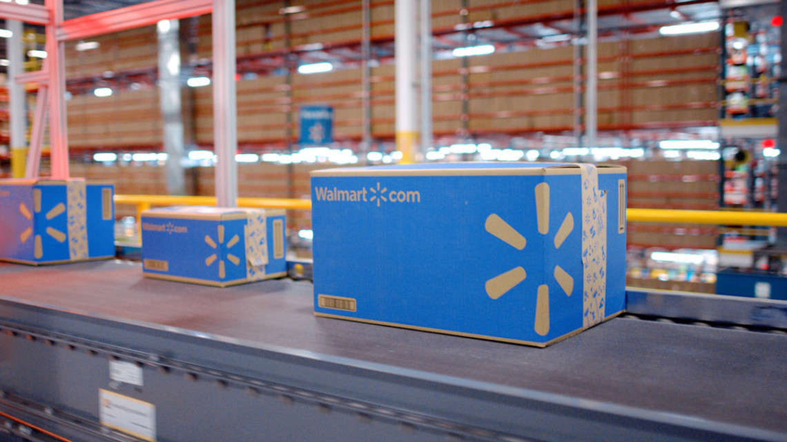 Walmart boxes on conveyor belt