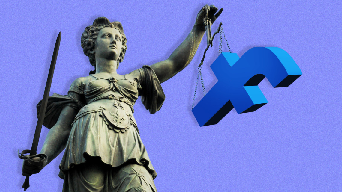 A Lady Justice Statue holding the Facebook logo