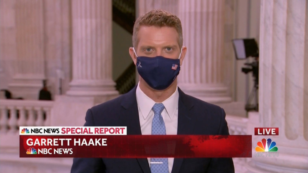 clip from nbc news special report of garrett haake at the capitol with a blue mask on