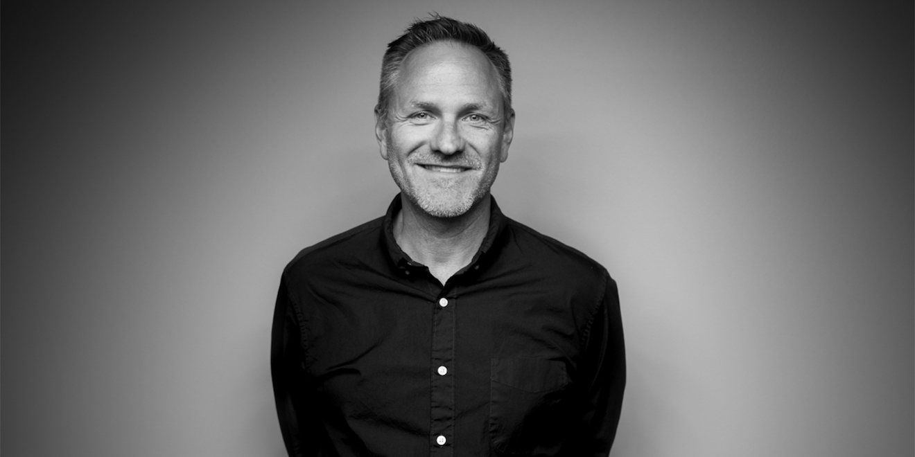 black and white photo of a man smiling