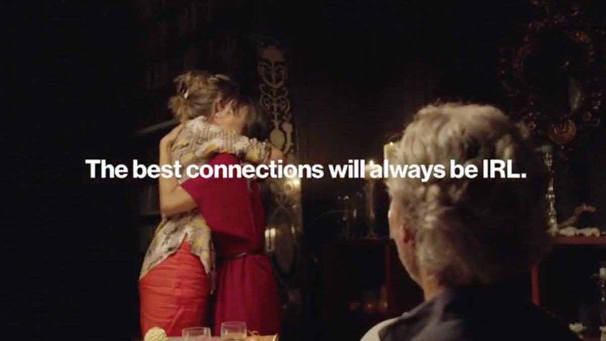 two people hugging as one person looks, with text that reads: the best connections with always be IRL.