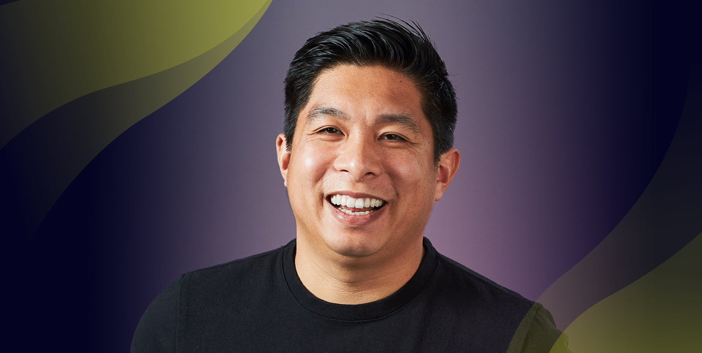 Eric Toda headshot against grey background with Innovators yellow theme on top left corner.