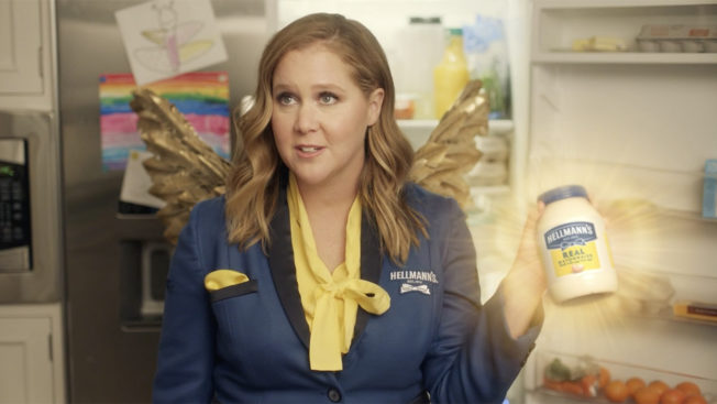 amy schumer holding a hellmann's mayo container