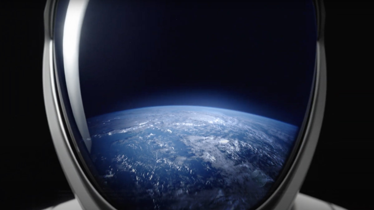 view of earth reflected in an astronaut's helmet