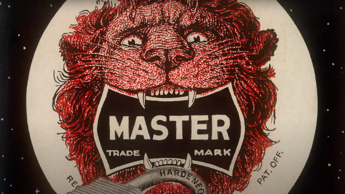 a red lion with a master lock in its mouth