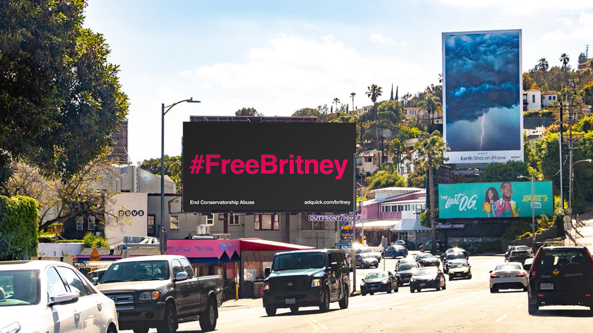 billboard among cars that says #FreeBritney