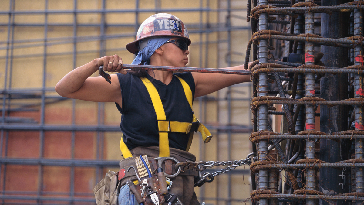 A woman working with rebar