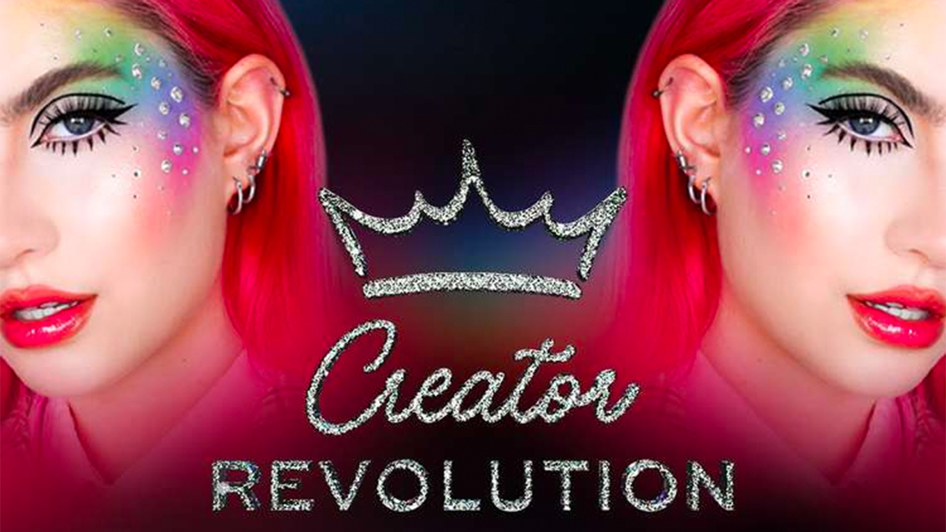 A person with red hair and dramatic makeup is shown in a promotional image for Creator Revolution
