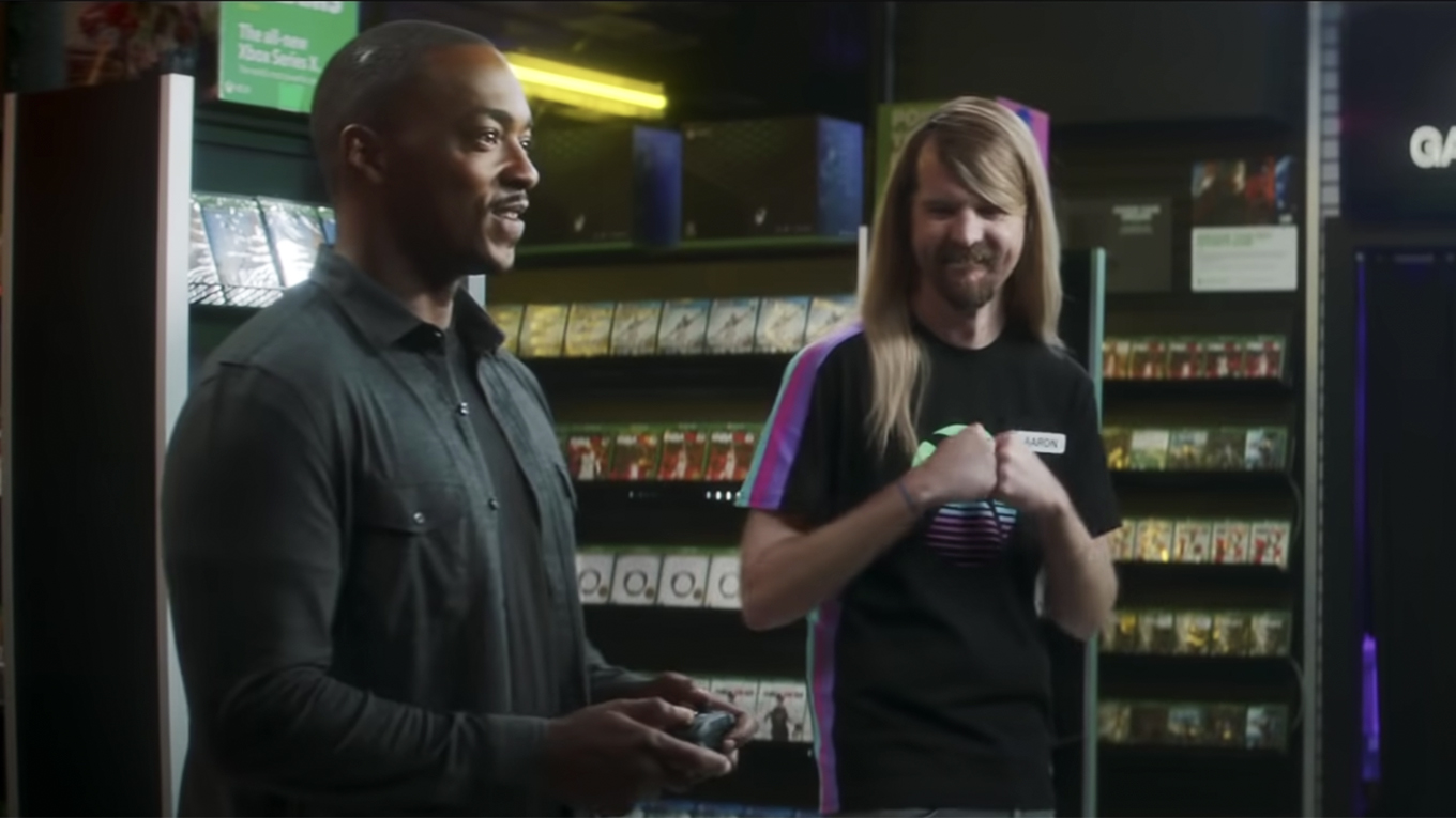 Actor Anthony Mackie plays Xbox with a clerk in a video game store