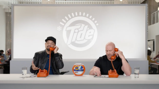 ice-t and stone cold steve austin calling people while surrounded my tide-themed merch