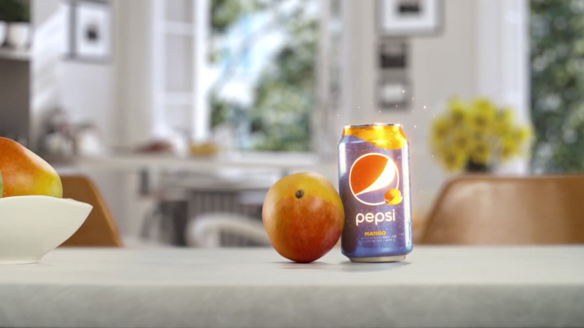 a photo of a can of pepsi mango next to an actual mango fruit