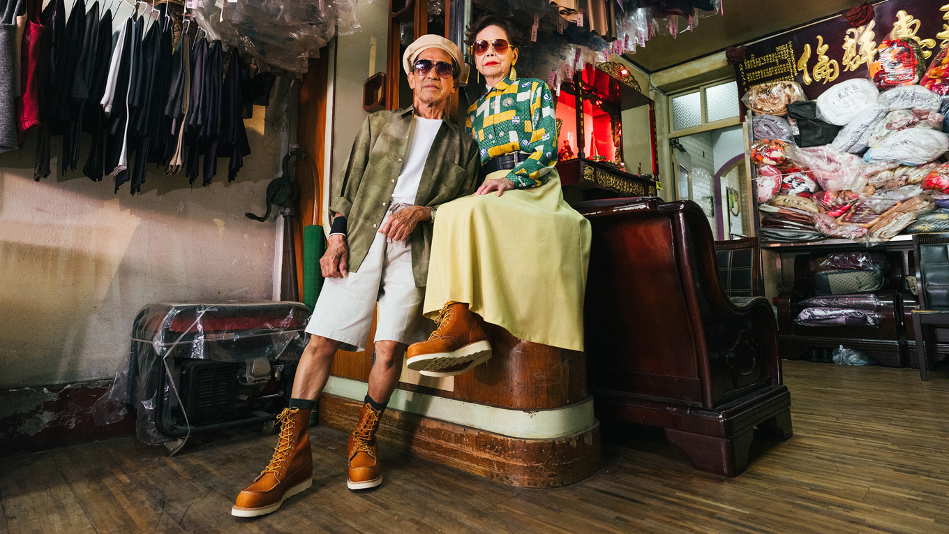 Wan-ji Chang and his wife Sho-er model clothing left unclaimed in their laundromat. Now, they have some Red Wings to wear, too.