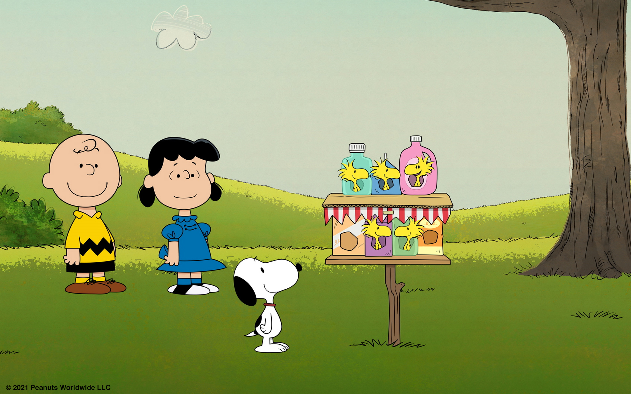 The Peanuts gangs looks fondly at a new birdhouse made of recycled materials