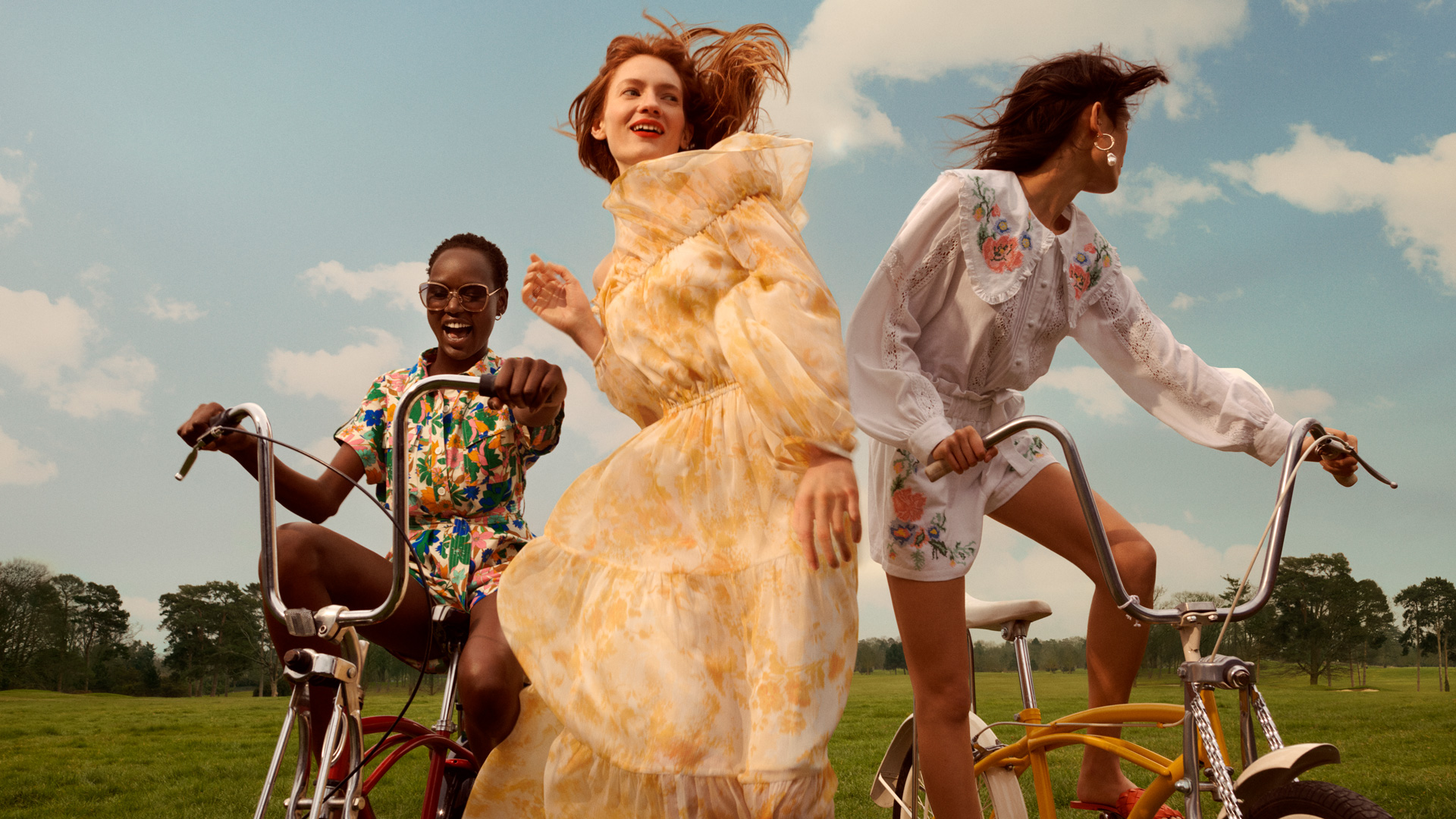 Four models cycle through the countryside