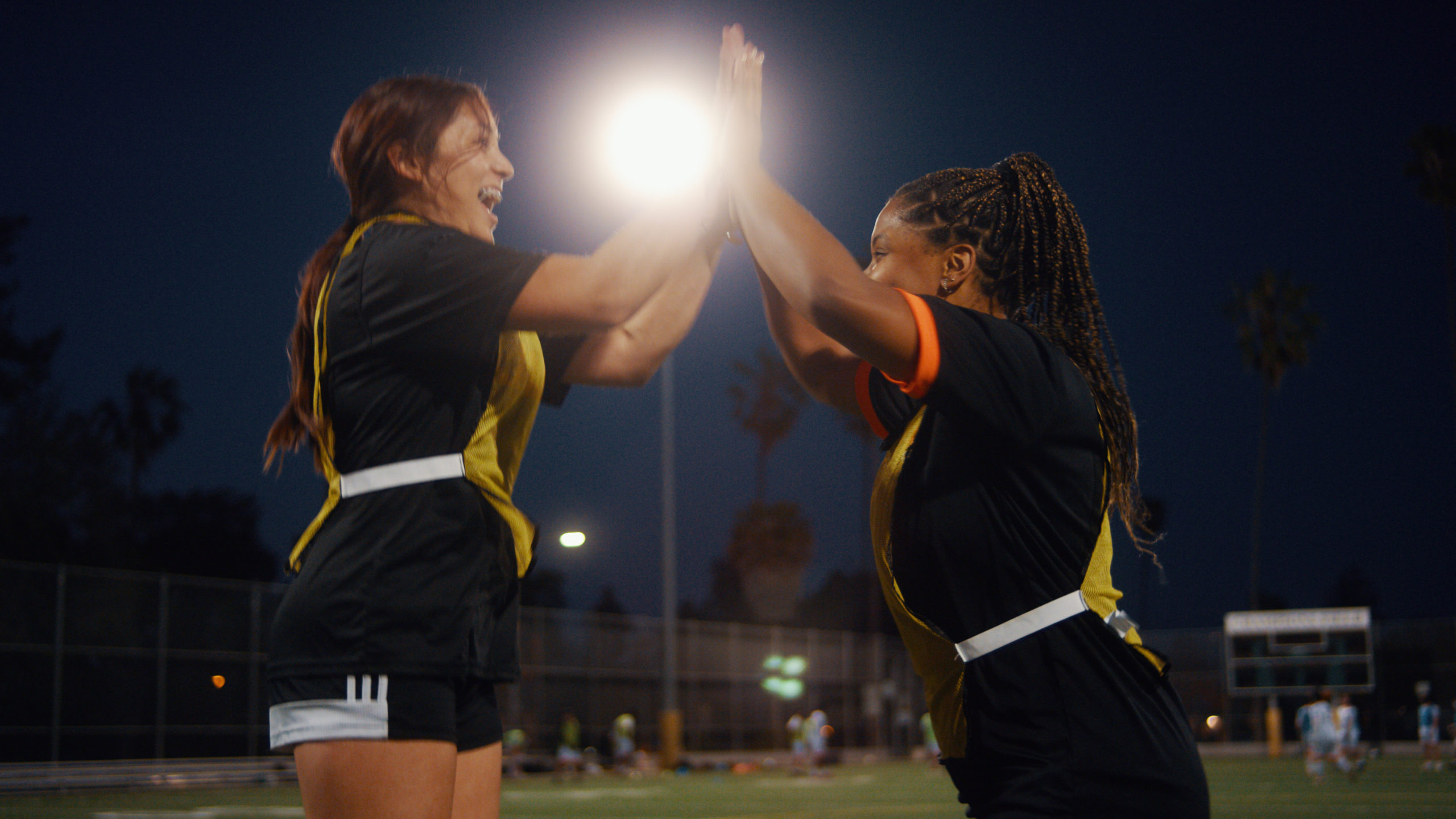 Two female athletes high-fiving