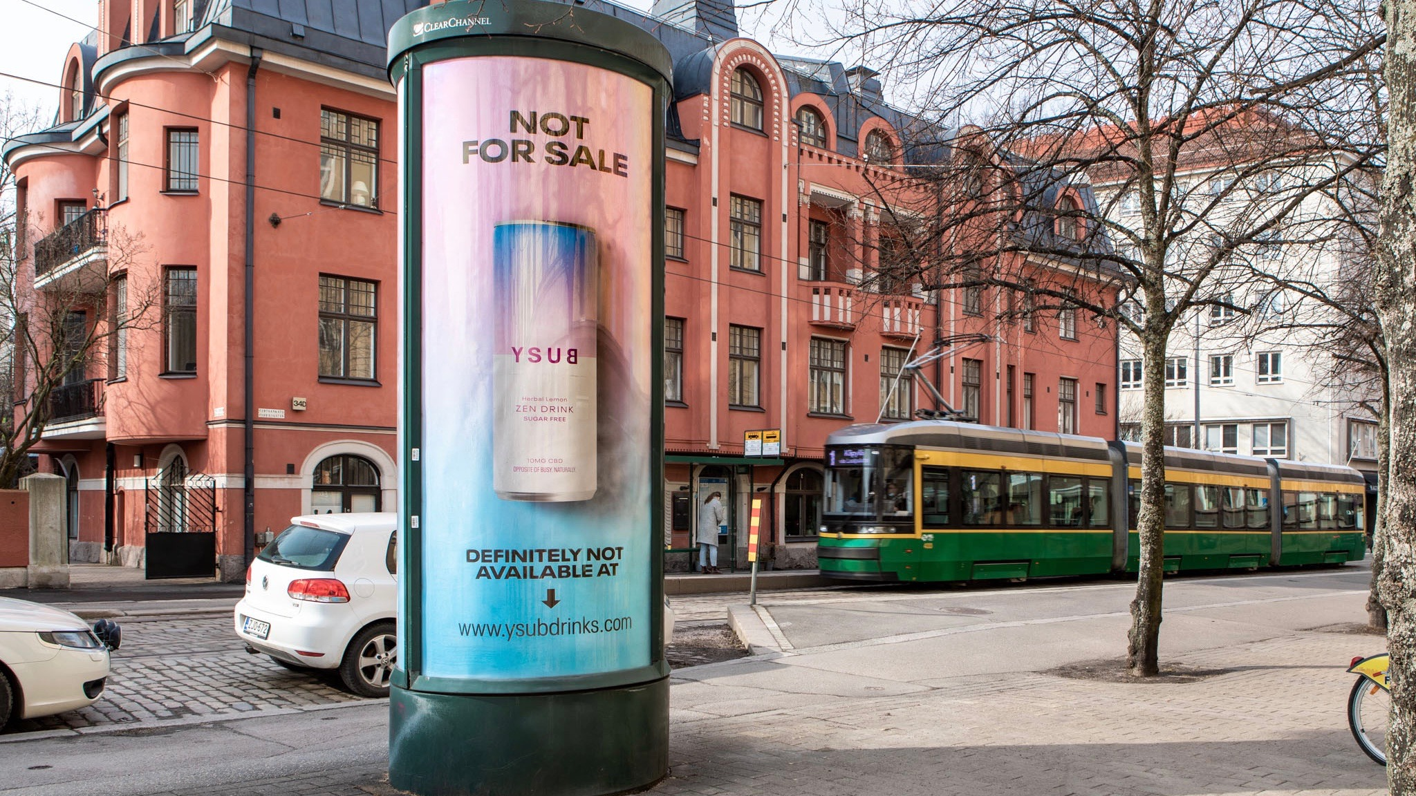 A cylinder-shaped outdoor ad on a street corner in Finland for CBD drink YSUB shows a can of the drink and says it's not for sale