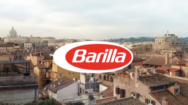 pasta brand barilla logo with a town as a background