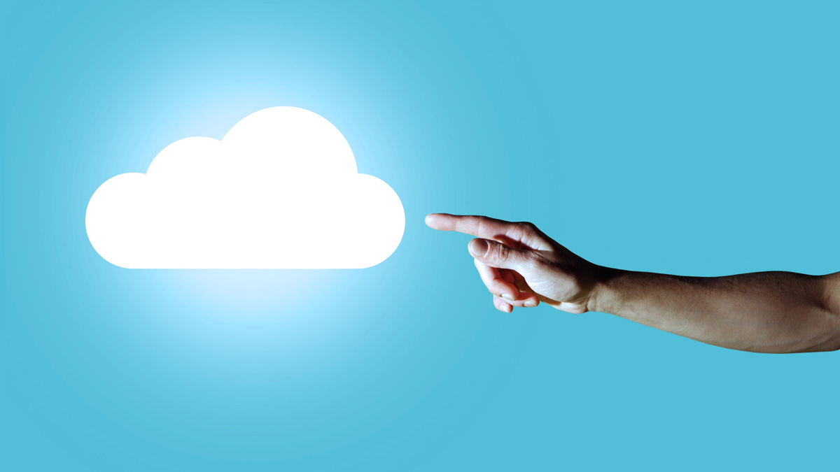 a hand pointing at an illuminated cloud