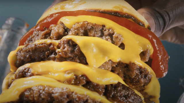a close-up photo of a four-tiered cheeseburger
