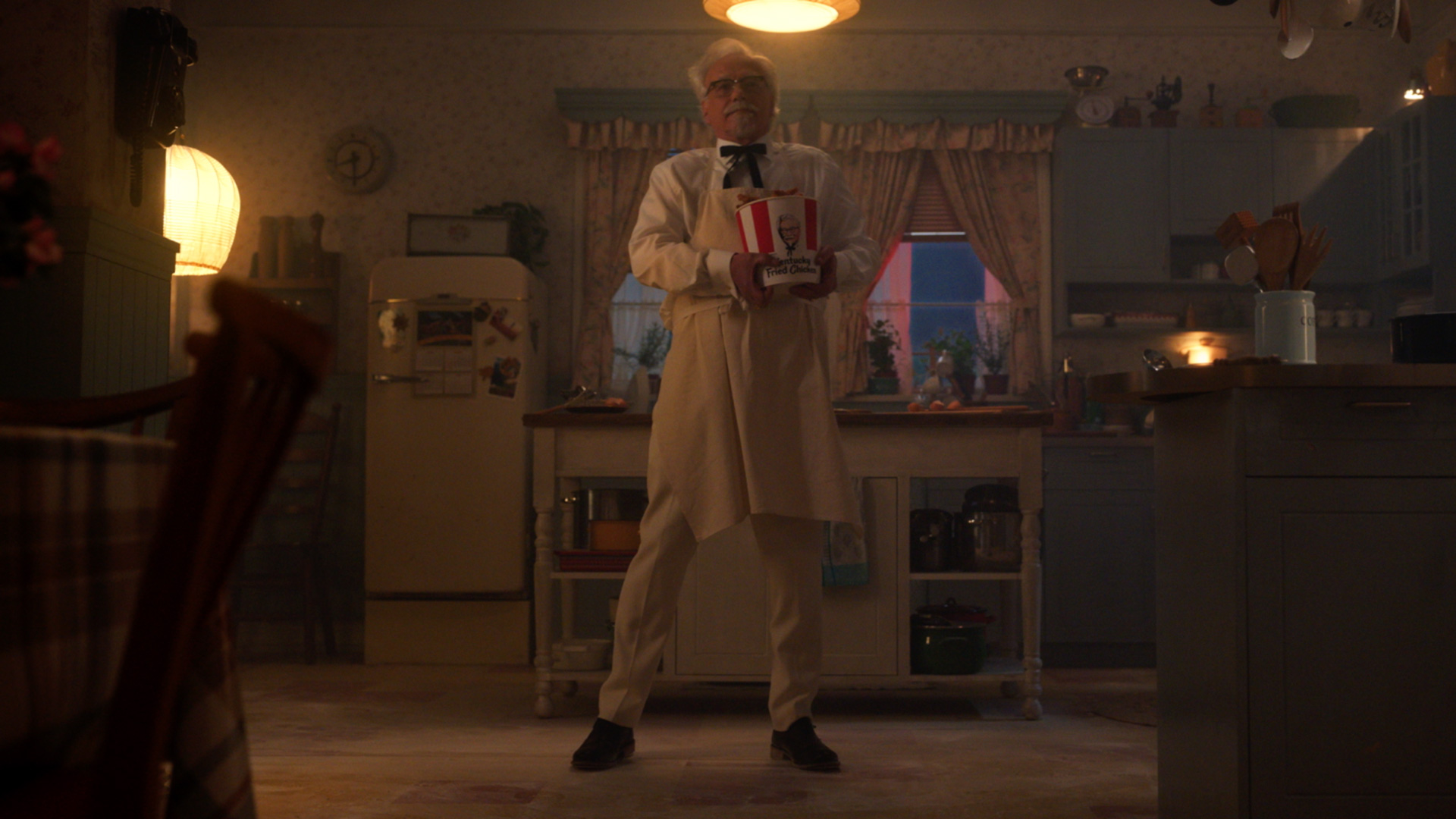 Colonel Sanders standing in a kitchen