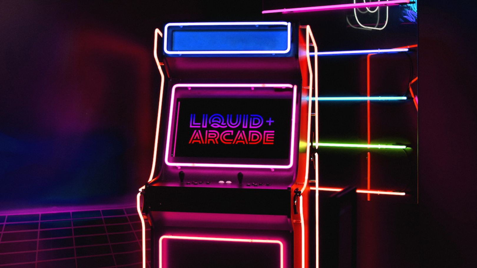 The new branding for Liquid Agency centers around a neon, retro gaming aesthetic