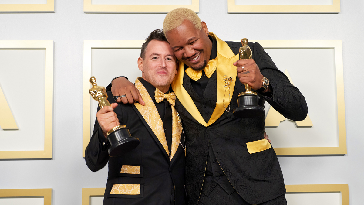 Writer Travon Free (right) and Dirty Robber creative director Martin Desmond Roe holding their Oscars for Best Live Action Short Film