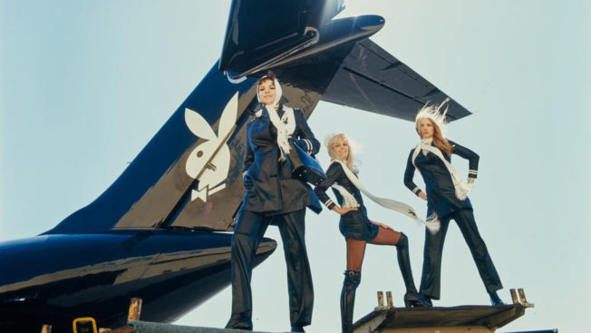 women standing outside of a playboy bunny black jet