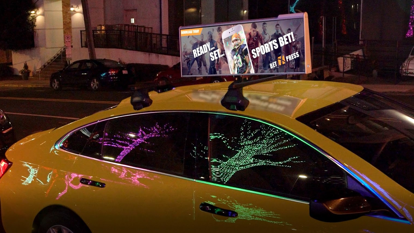 Uber screens will adorn yellow cabs in NYC.