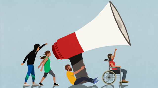 people holding up a giant megaphone