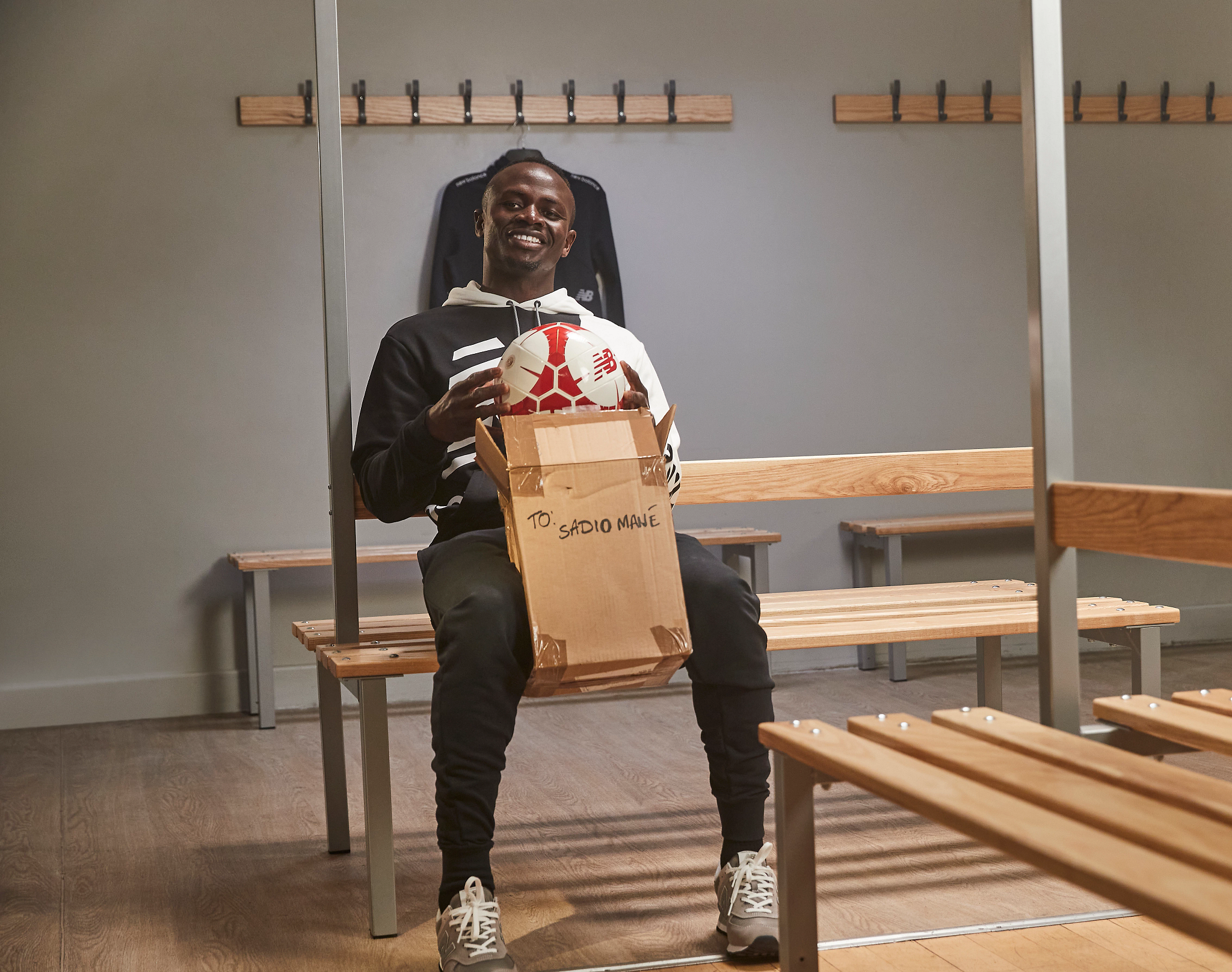 Man smiling while pulling a ball out of a box