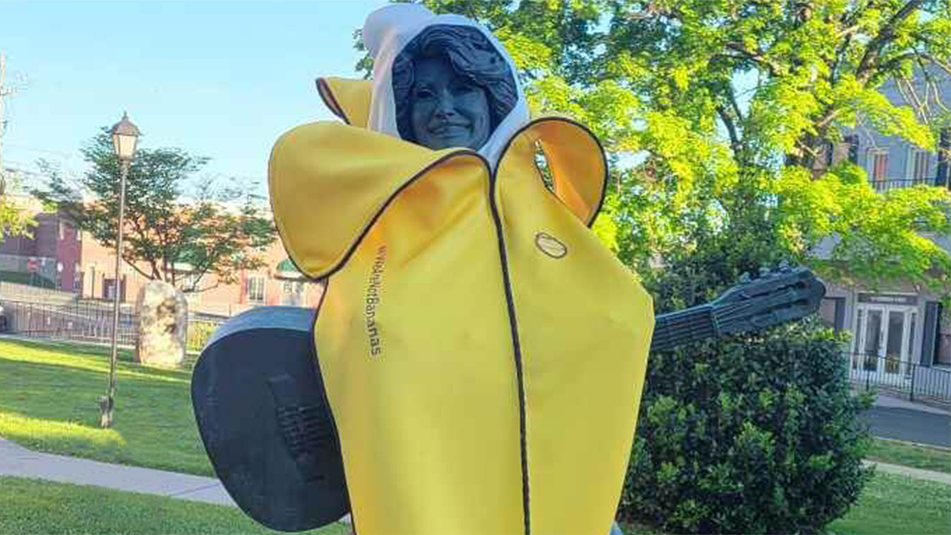 dolly parton statue in a banana costume