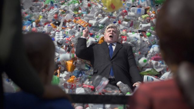 A plastic replication of Boris Johnson is covered in plastic bottles
