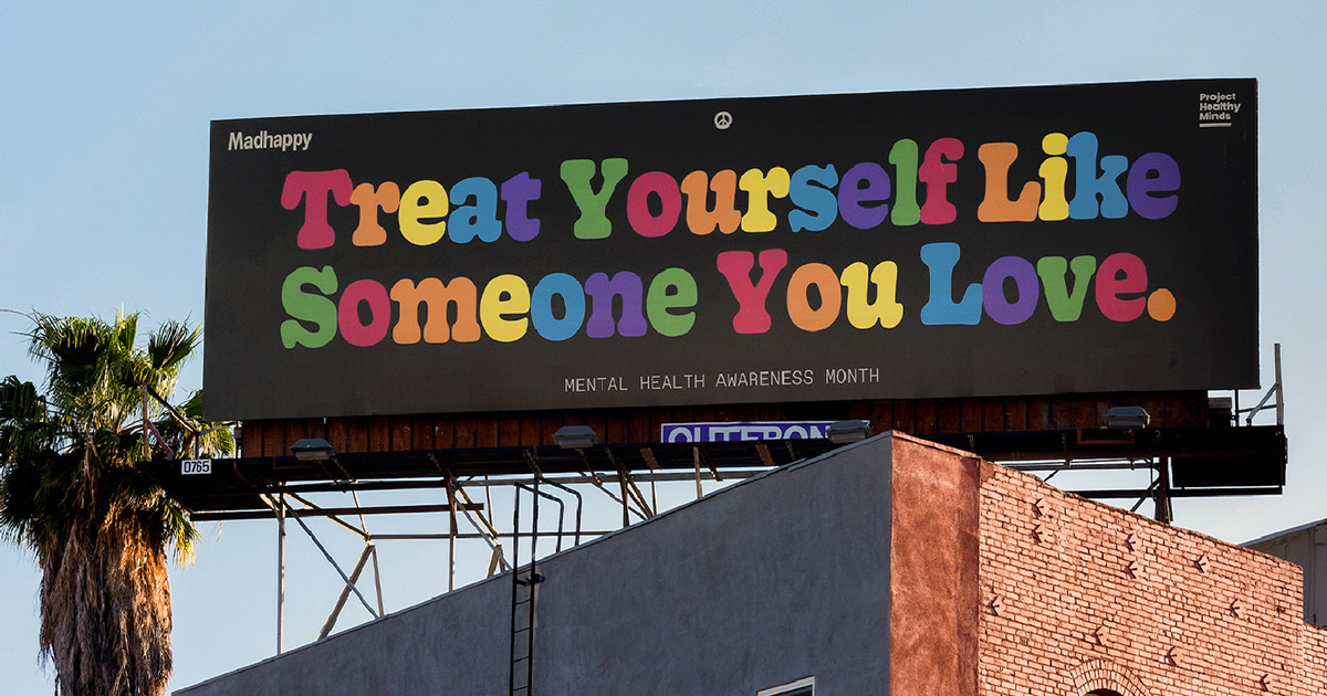A billboard that says, 'Treat yourself like someone you love'