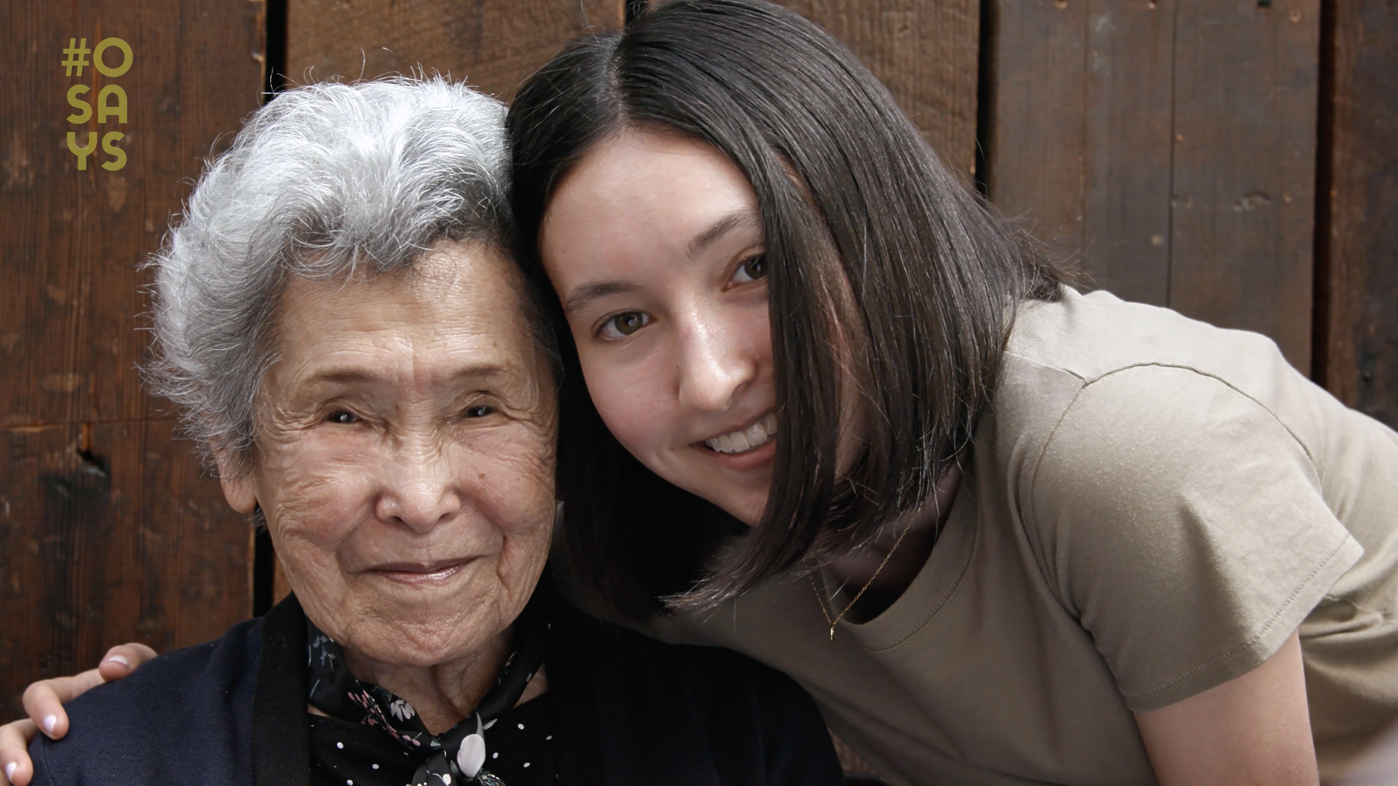 An older woman and younger woman embracing and smiling