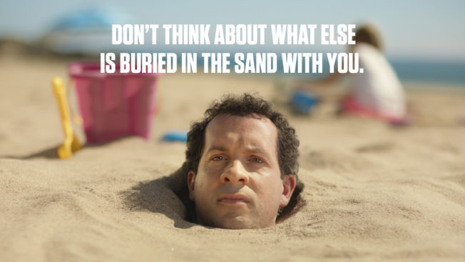 Man buried in the sand
