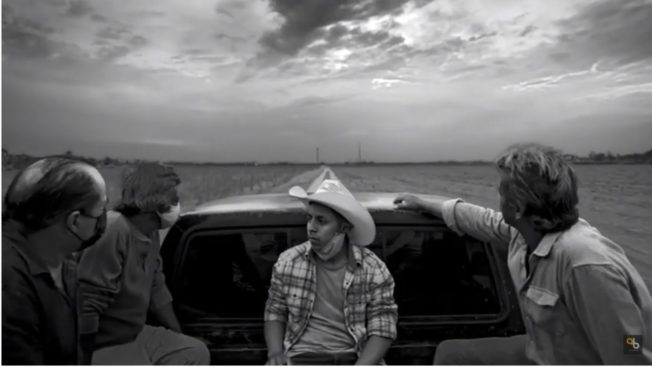 Mexican workers in the back of a pick up truck