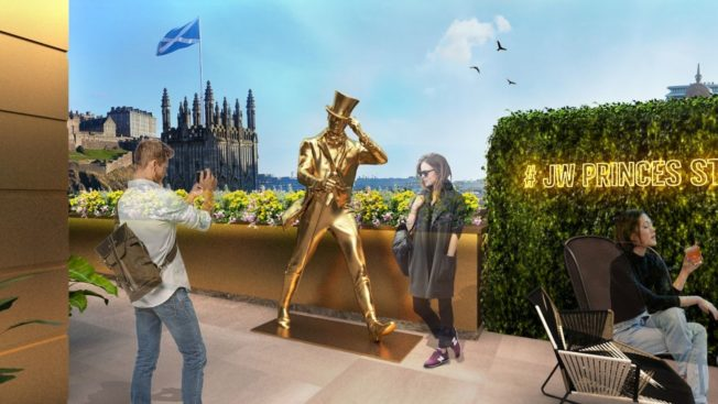 The Striding Man on the roof of the Johnnie Walker Prince's Street Experience