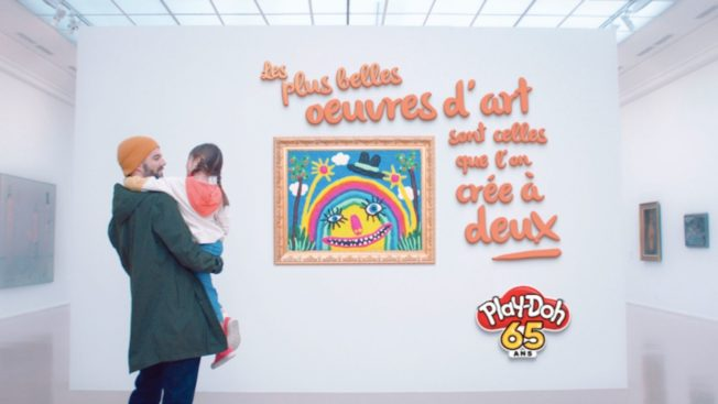 A father and daughter inspect their handywork using Play-Doh
