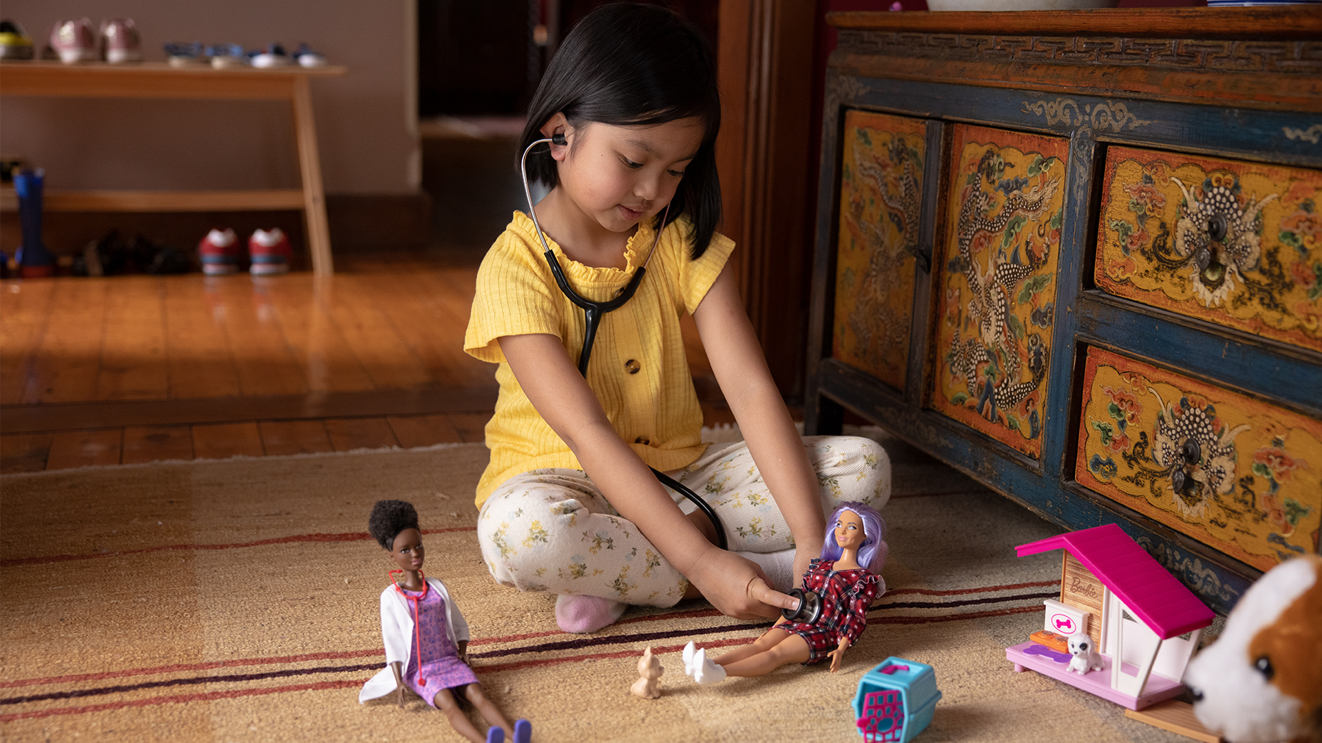 Photo of a girl playing with Barbie dolls