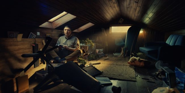 Man sits in attic having destroyed it