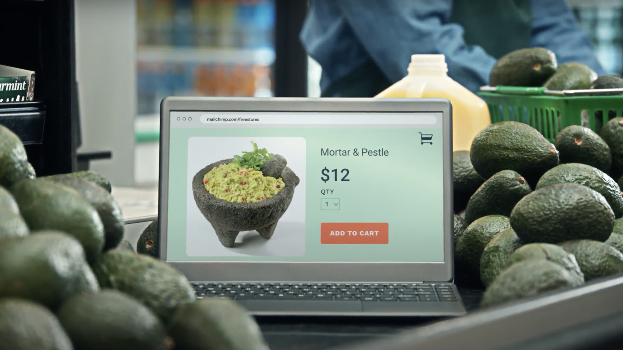 a laptop screen with an image of a bowl placed in a bin of avocados