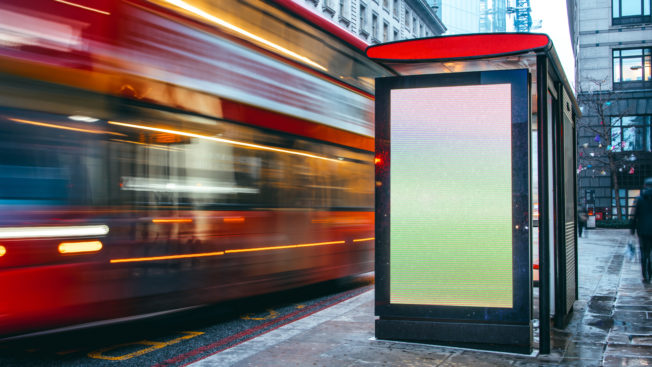 Outdoor advertising at a bus stop in a city