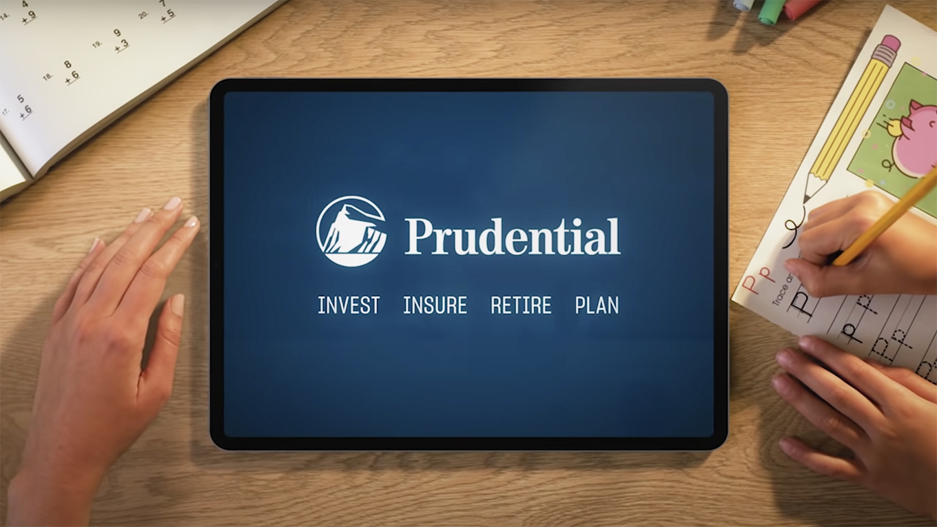 A tablet on a table shows the Prudential logo