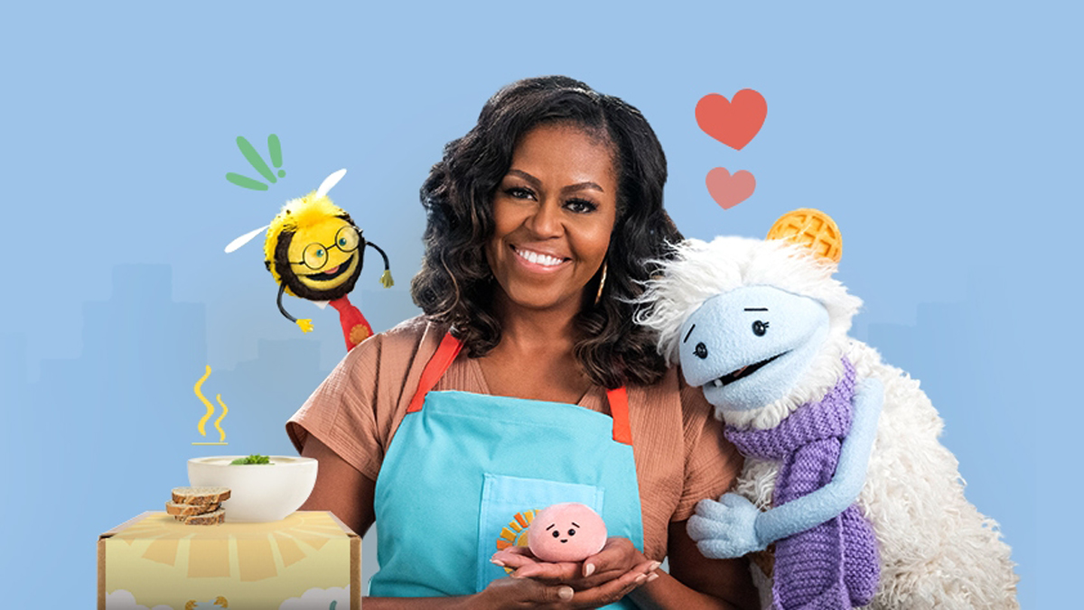 michelle obama smiling and hugging puppets waffles and mochi
