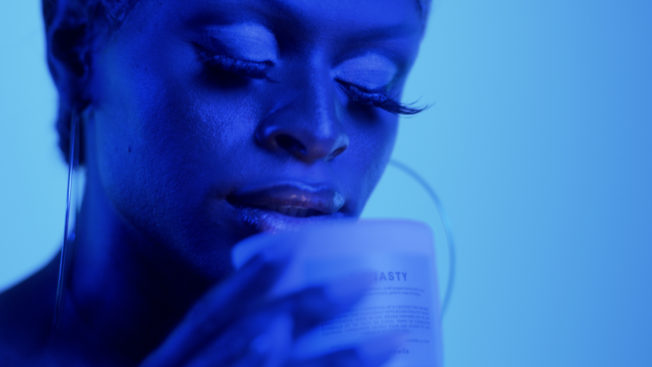 A woman sniffing a candle