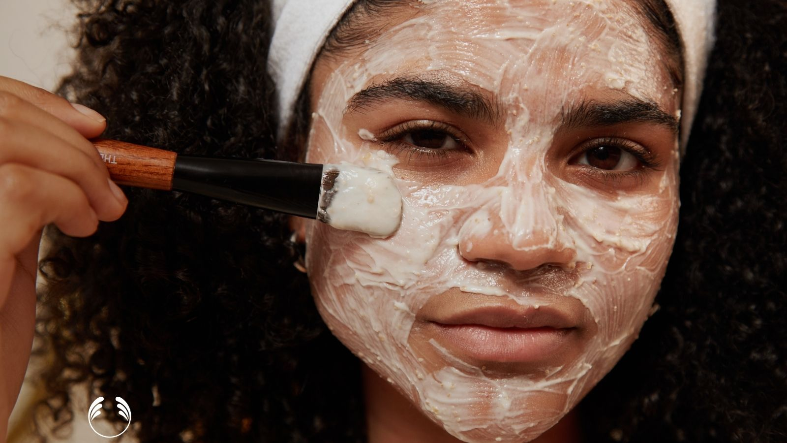 A lady puts on a face mask
